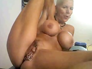 horny granny on cam, with many rings on her
