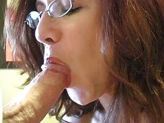 redhead momma with biggest boobs and glasses