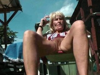 hairy older smoker flashes her pussy and gazoo