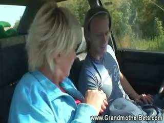 granny enjoys engulfing cock in car