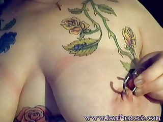 tattooed pantoons milf with large gauge nipple