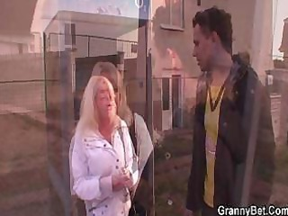 lad picks up golden-haired granny and bangs her