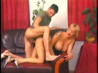 blonde mama with ideal jugs pumped on a leather