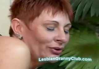 hot redhead granny bows on her all fours to take