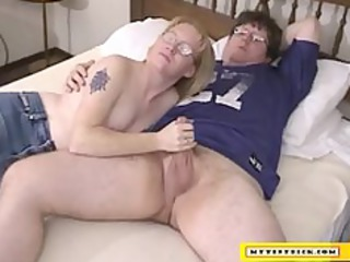 aged blond engulfing on a diminutive cock
