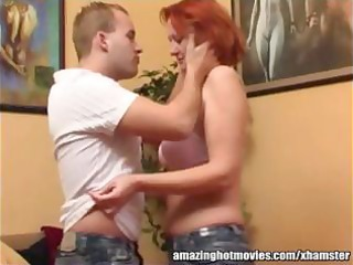 mature redhead getting her melons kissed and