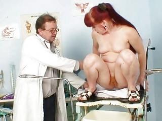 older olga has her redhead hairy pussy gyno specu