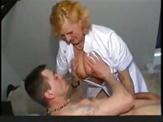 overweight blonde granny nurse gives her patient