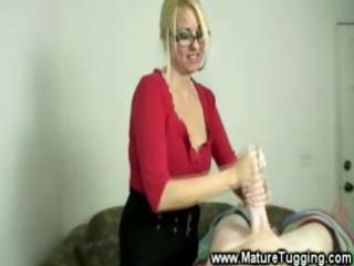 cheeky milf enjoys tugging dick