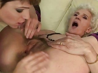 granny enjoys lesbo sex with young beauty