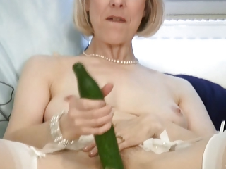 aged housewife bonks a cucumber