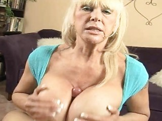 tanned blonde momma with giant hooters doing