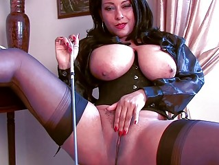 arousing brunette momma in corset and nylons