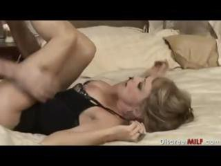 aged milf with youthful stud in bedroom