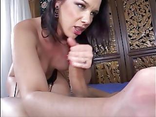 brunette in garters sucks pink sex-toy during the