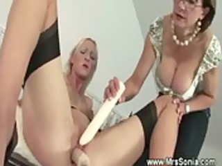 lesbo makes older chick receive an big o