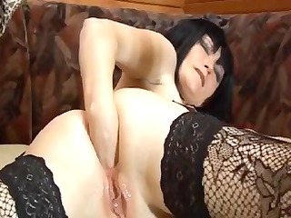 older brunette hair bitch in lacy stockings fists