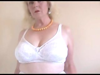 older breasty lady in stockings and sheer slide