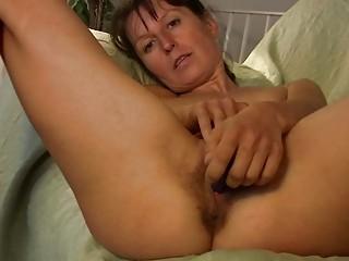 slim dark brown milf in red undies plays with her
