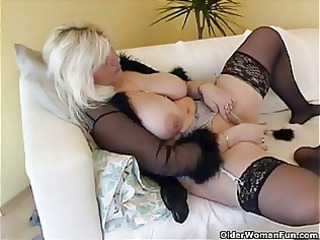 corpulent housewife in nylons plays with recent