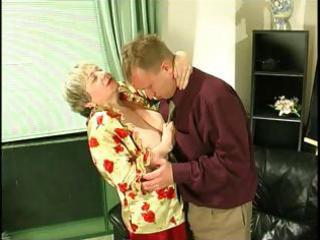 corpulent golden-haired granny uses her giant