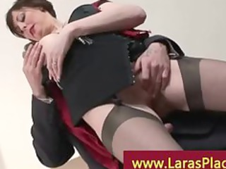 stylish older lady in stockings and heels up for