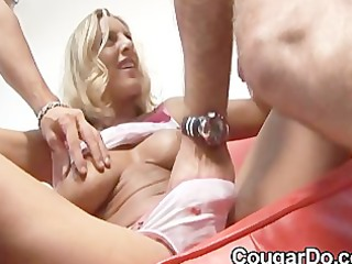 bonde milf gives a tugjob and oral stimulation