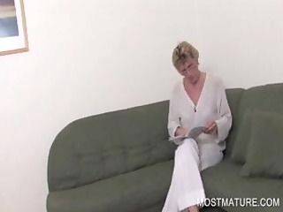 blond mature spreading pink cunt