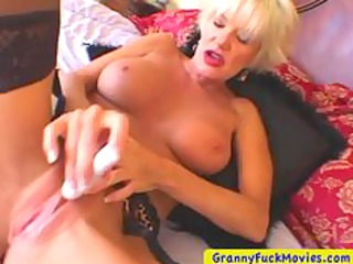 blonde mature playing with a petite toy