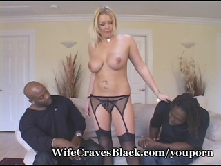 golden-haired wife engulfs dark men