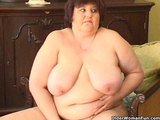 chunky granny with big breasts bonks a vibrator