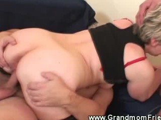 granny rides one jock and sucks the other weenie