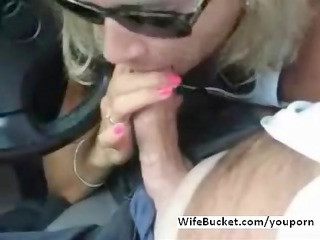wife gives blowjob in car