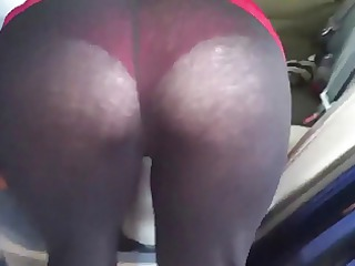 my wife cleaning the car in watch thru leggings