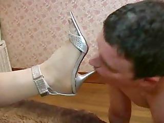 mature female-dominator - licking her feet, ass