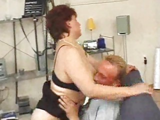 aged redhead sucks and licks and spits on sex toy