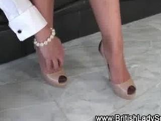 older brit femdom shoe posing for the camera