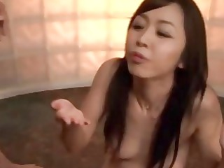 oriental milf enjoying the results of a bukkake