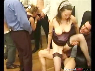 group of males on one older slut