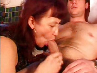 mature redhead with dark nylons sucks penis in