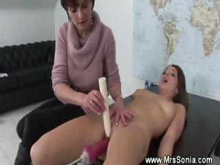 mature lady toys a brunettes pussy