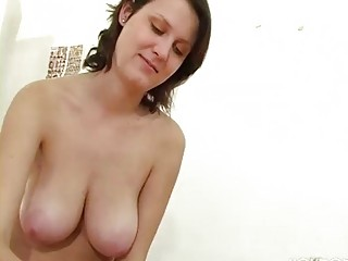 older beauty with big tits gives a cook jerking