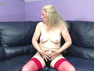 immodest old grandma masturbating on the sofa
