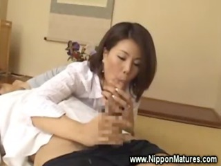 horny asian housewife plays with schlong