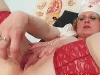 immodest milf in nurse uniform shows big milk
