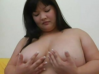 large oriental momma with big milk shakes plays