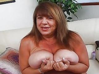 older momma with extra huge bosom sticks sex toy