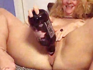 aged puts a bottle in her fuck aperture