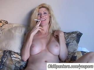 beautiful blond milf enjoys a smoke break