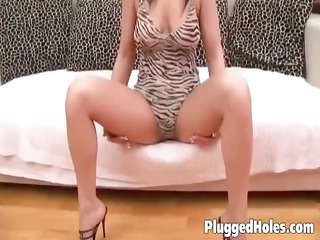 sexually excited slut drilling herself on sofa